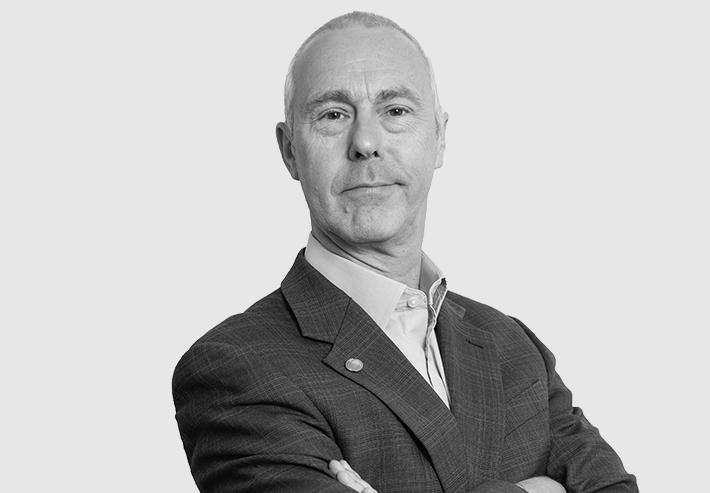 A headshot image of Gordon Garrard