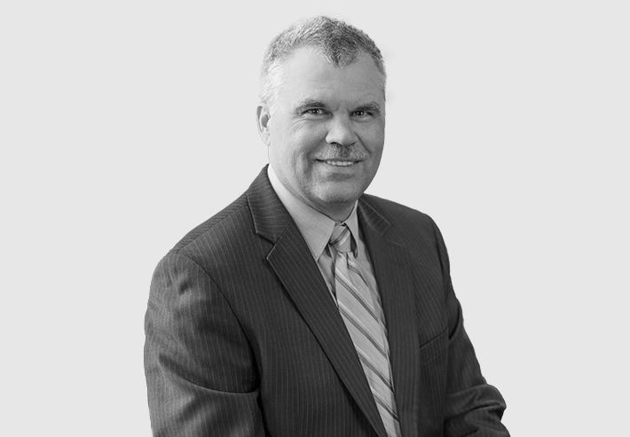 A headshot image of Kirk Jennings
