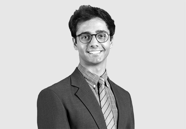 A headshot image of Arjun Sethi